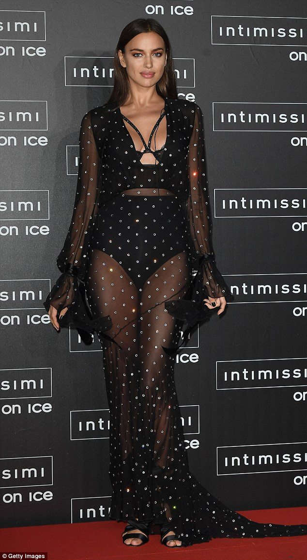 Natural beauty: Irina Shayk, 30, looked sensational as she glided along the scarlet walkway in a sexy sheer dress at the Intimissimi On Ice in Verona, Italy, on Friday night