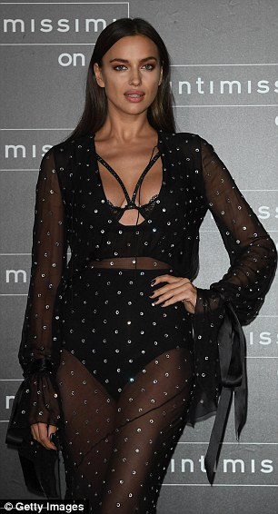 Body-confident: The Russian stunner's plunging neckline revealed plenty of cleavage with a decorative black bra keeping her assets in place