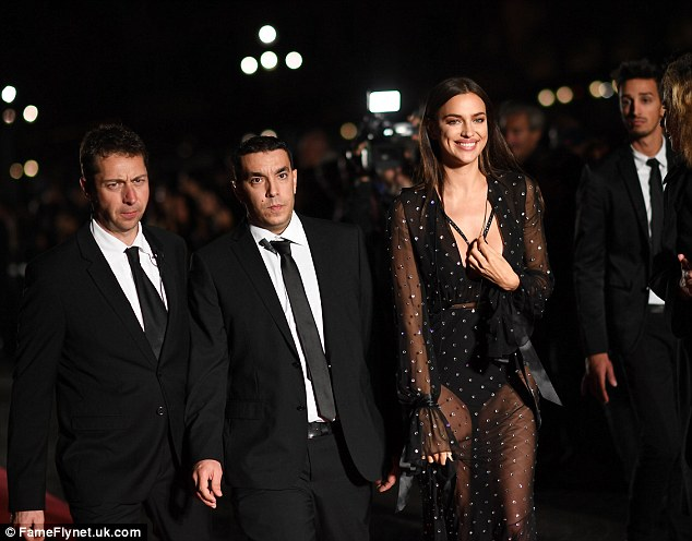 Showstopper: Irina's beautiful smile lit up as the camera snapped away