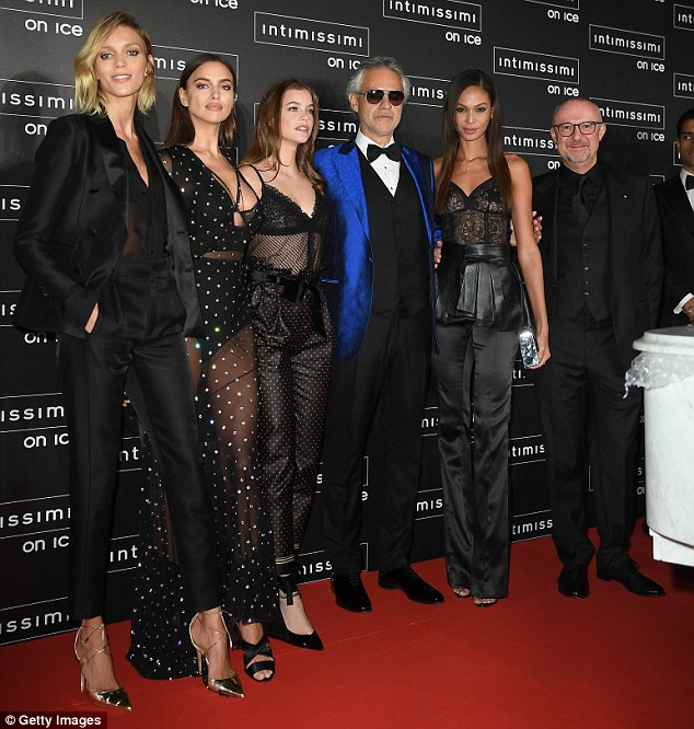 Main man: The beautiful girls posed alongside operatic legend Andrea Bocelli, who looked suave in a bright cobalt suit jacket