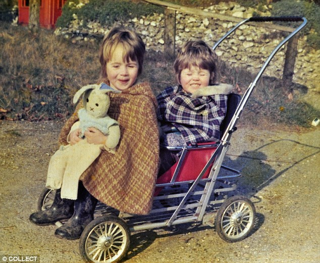 Amanda Holden, left at 4-years-old, sharing a seat with her sister Debbie aged 3
