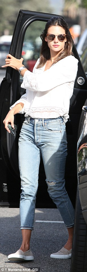 It's jean-etic:For her school run, the model donned a pair of distressed high-waisted Levis which were no doubt from her love Jamie Mazur's denim line RE/DONE