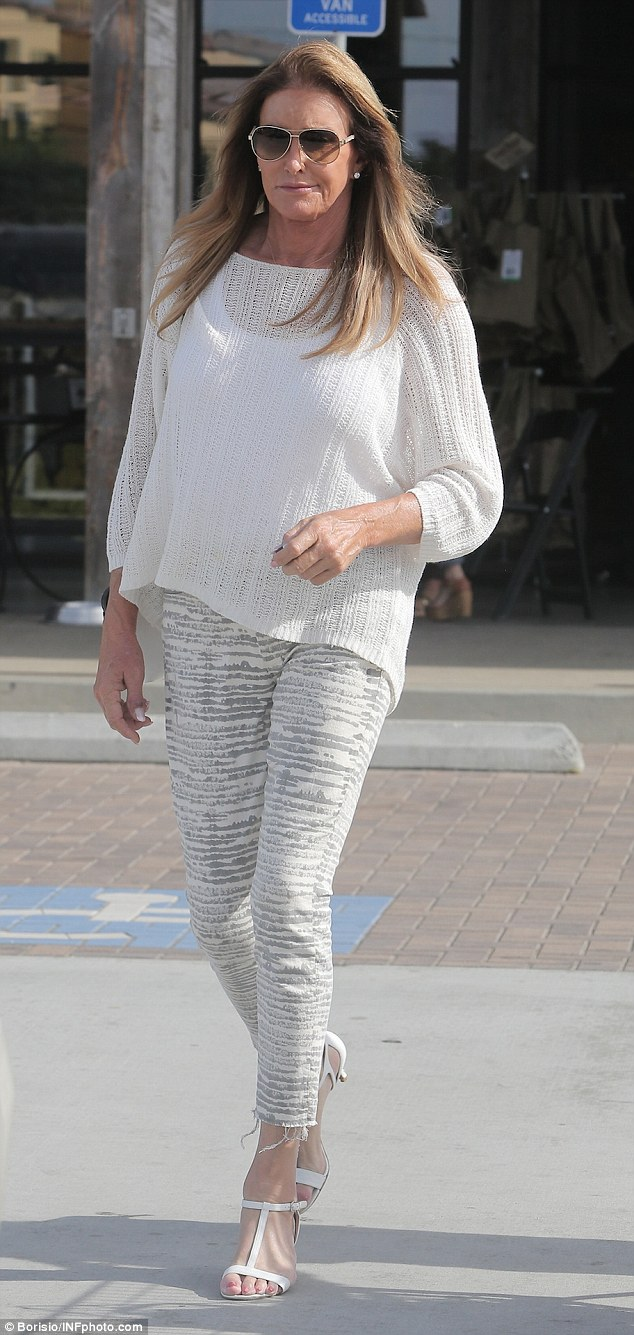 Glam is back! Caitlyn Jenner clearly made an effort with her wardrobe on Friday as she stocked up on groceries wearing trendy gray and white distressed cotton pants and white heels