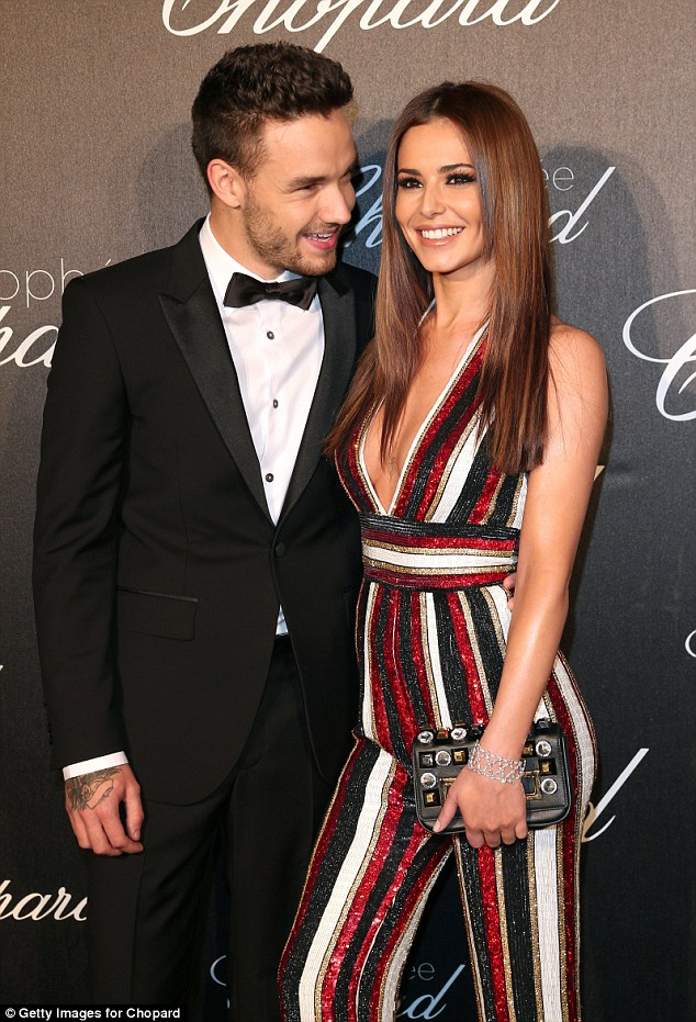 New love: Cheryl has been ploughing ahead with her relationship with One Direction's Liam (pictured here together in May)