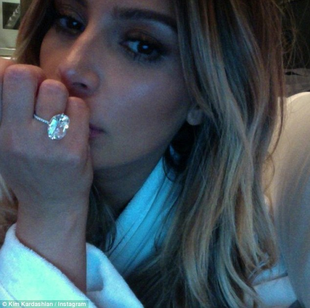 The star has earned millions through self-promotion since first appearing on Keeping Up With The Kardashians nine years ago. Pictured: Kim wearing the £3.5m ring believed to have been stolen from her Paris hotel room
