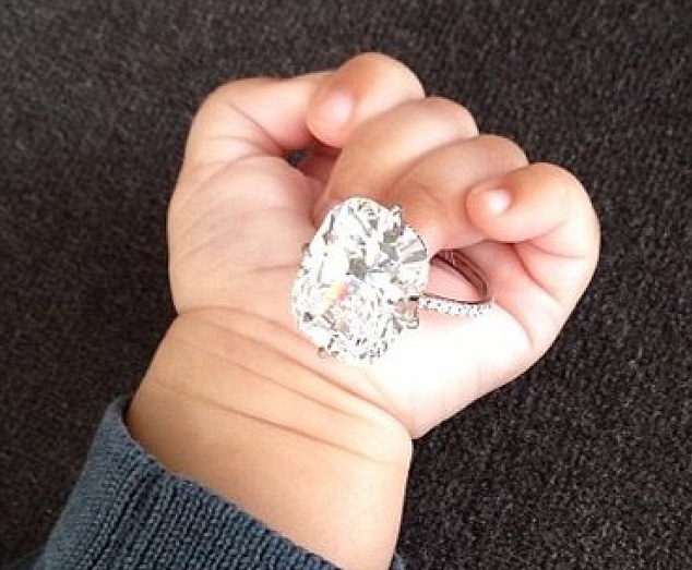 'She has made $100million (£81m) from her fabulous looks, body and public persona,' said Smith. 'But now she doesn't need to go on doing that because there are other members of the family to promote the Kardashian brand. Pictured: Saint holding her 20-carat diamond ring