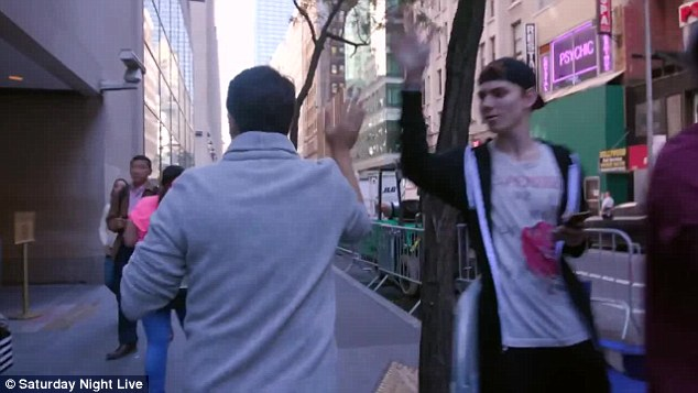 Give me five! The Broadway star gave a high five to one passerby