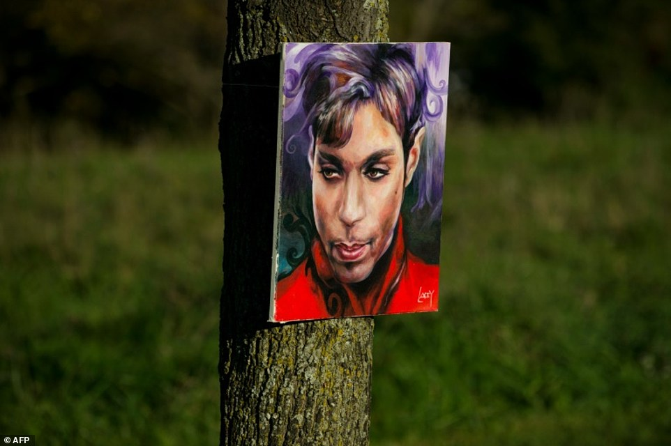 Never forgotten: A portrait of Prince by artist Daniel Lacey hangs outside Paisley Park