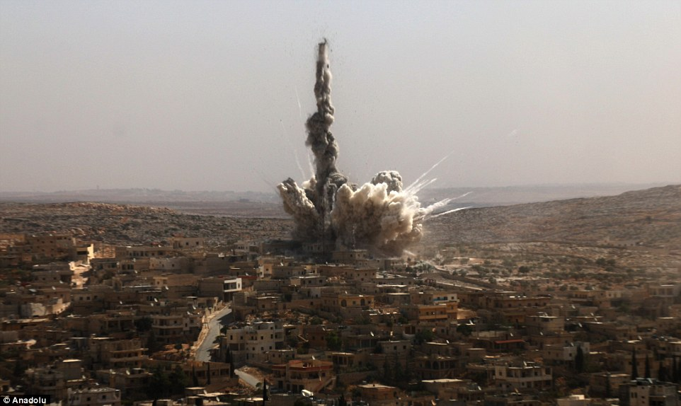 Smoke rises after an attack on the Darat Izza neighbourhood in Aleppo