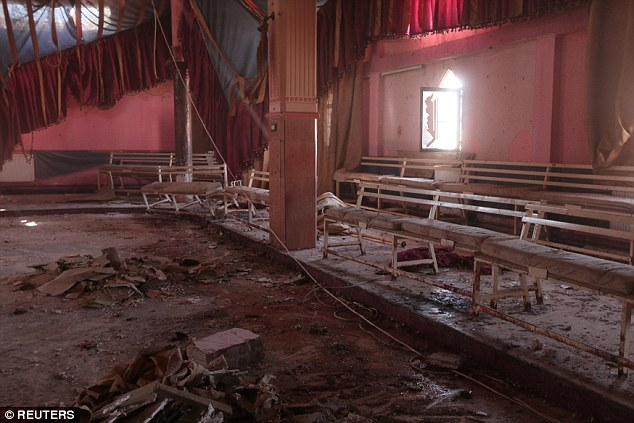 Blood stains the ground of a damaged wedding hall after the suicide attack on a Kurdish wedding in Hasaka city, Syria
