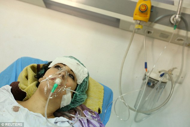 A woman, who was wounded in the bombing at a Kurdish wedding lies in a hospital in Dohuk province, Iraq