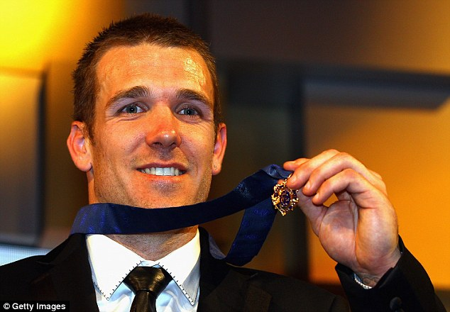 Swan was awarded the Brownlow Medal in 2010 and 2011 (pictured), but at the start of the 2016 season he suffered a foot injury that ended his career