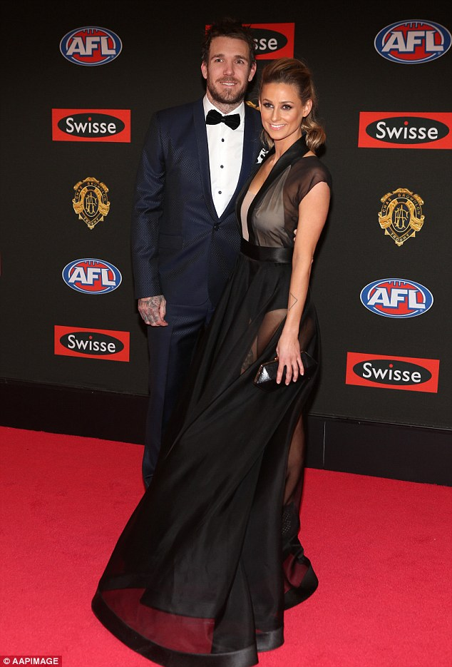 Swan posing on the red carpet of the 2015 Brownlow Medal Ceremony with his partner of eight years Taylor Wilson