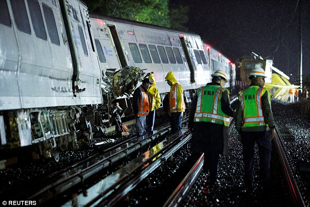 Investigation: Emergency responders work on the Long Island Rail Road train that derailed near Hyde Park