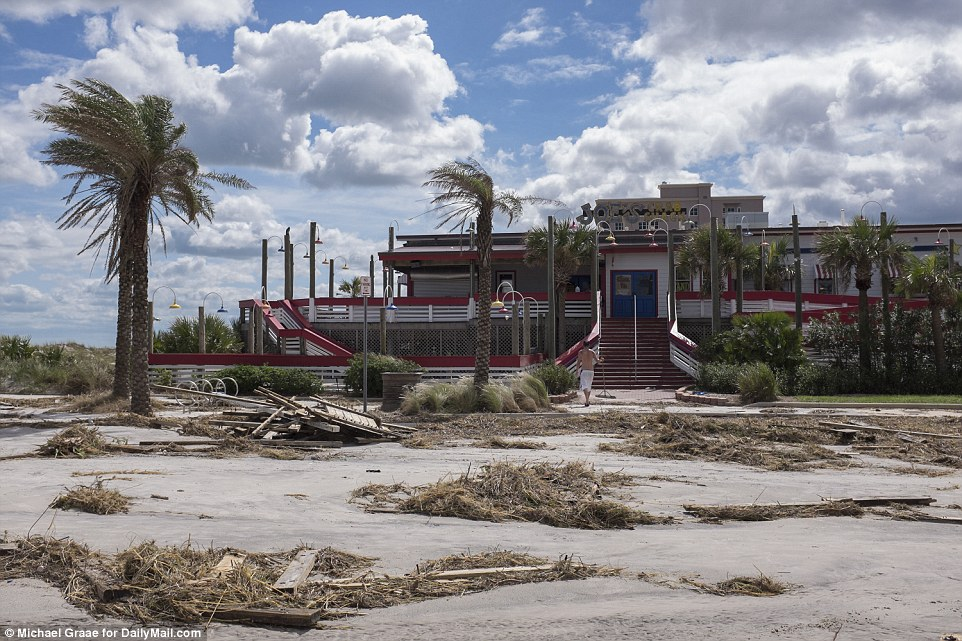 Balmy weather and clearing skies:Debris in front of Joe's Crab Shack following Hurricane Matthew in Jacksonville Beach