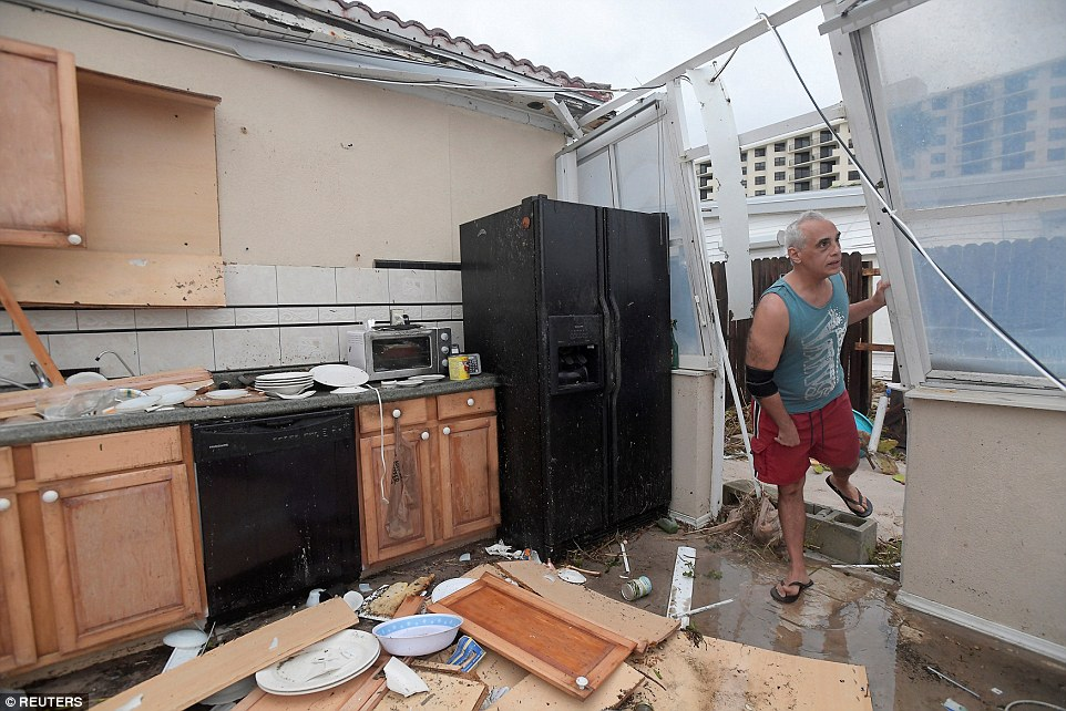 In Ormond Beach, Florida, Joe Lovece assesses the damage to his kitchen after the storm