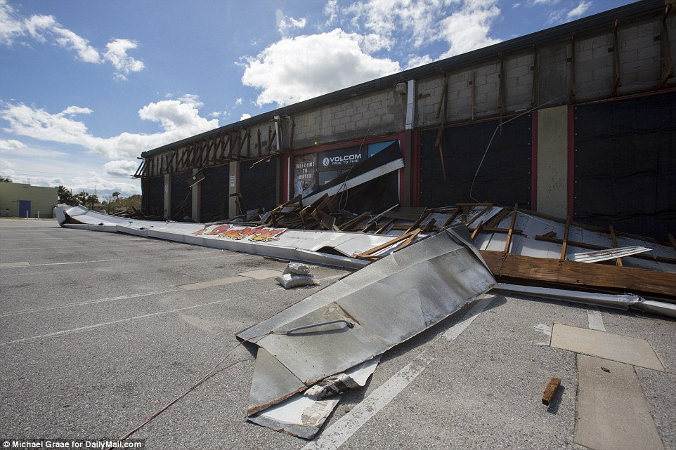 Damage: Sunrise Surf Shop, which had its awning ripped down by Hurricane Matthew