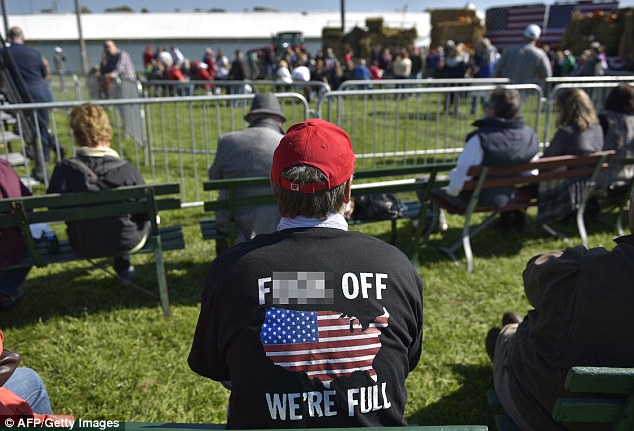 Trump supporters tried to shout down Paul Ryan at the speech on Saturday. Pictured is a Republican supporter wearing a t-shirt that reads: 'f*** off we're full'