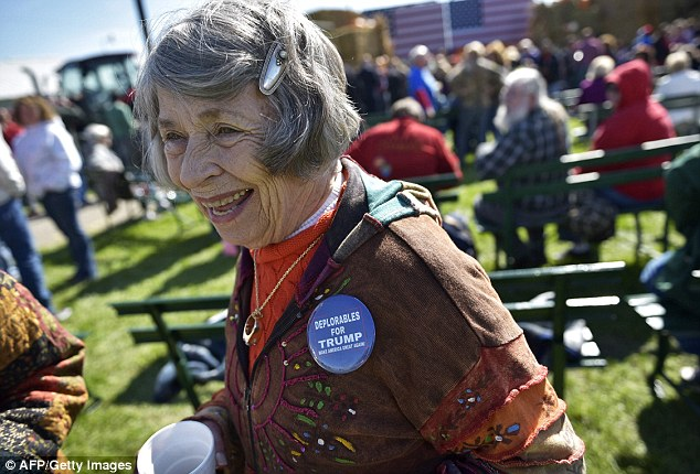 A woman at the Wisconsin Fall Fest on Saturday wears a badge on her top that reads: 'Deplorables for Trump'