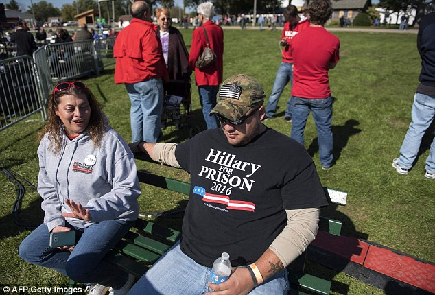 A man at the Republican event is seen wearing a t-shirt that reads: 'Hillary for prison'