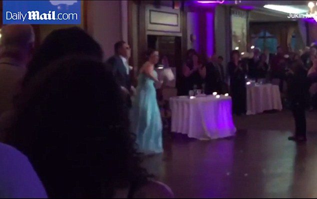 A dance teacher and his partner took an unfortunate tumble while dancing during a wedding reception