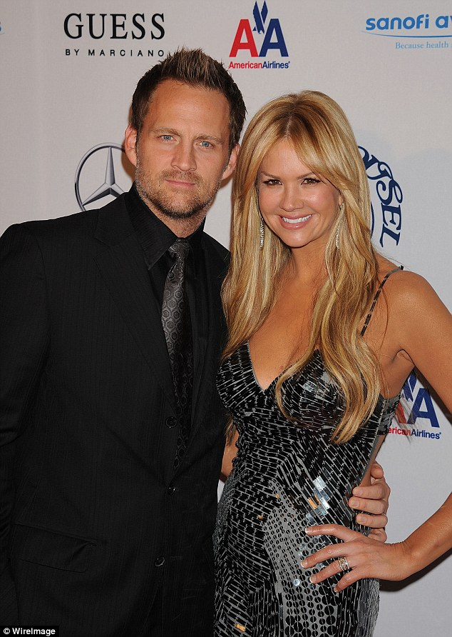 Nancy O'Dell and husband Keith Zubulevich attend The 32nd Annual Carousel Of Hope Ball in October 2010