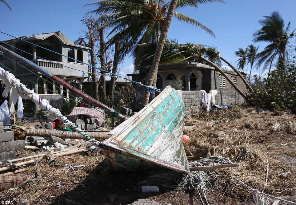 A boat was left ashore near some homes in Playa Gelee, Haiti, after the tides rose and then later receded following the hurricane