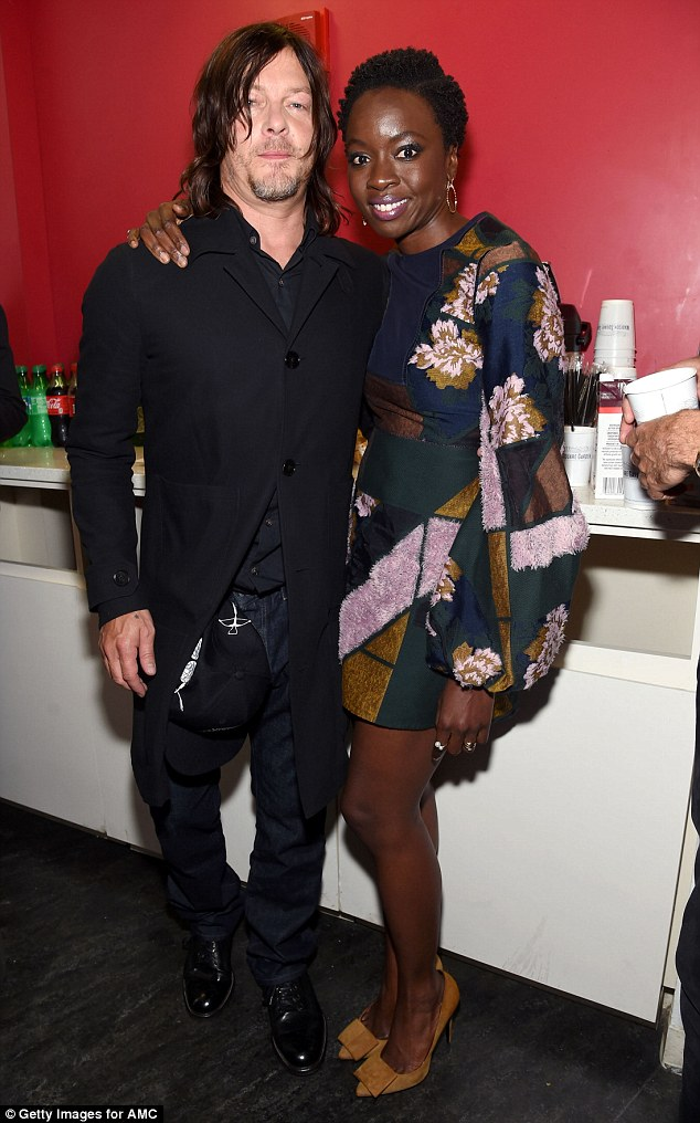 Hot cast: Reedus poses alongside co-star Danai Gurira, 38, who looked amazing in her glam get-up
