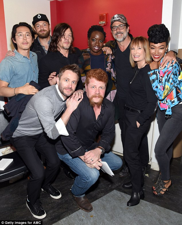 Gang's all here: The burning question was who will die in the season opener; pictured (L to R) Steven Yeun, Ross Marquand, Norman Reedus, Chris Hardwick, Michael Cudlitz, Danai Gurira, Jeffrey Dean Morgan, Gale Ann Hurd and Sonequa Martin
