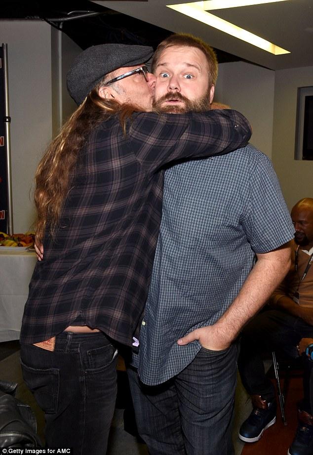 Good vibes: Producer Greg Nicotero, 53, hugs creator Robert Kirkman, 37, at the Saturday showcase