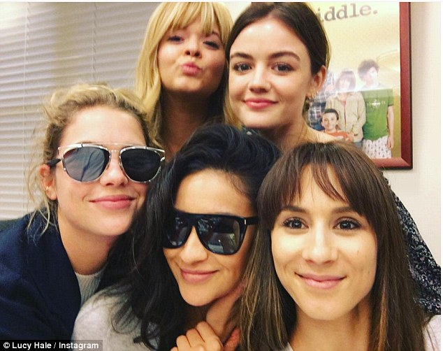 Quintet: On Thursday, Lucy Hale posted an Instagram photo of herself (back row right) and her Pretty Little Liars castmates Sasha Pieterse (back row left), Benson (front row left), Shay Mitchell (front row centre) and Troian Bellisario (front row right)