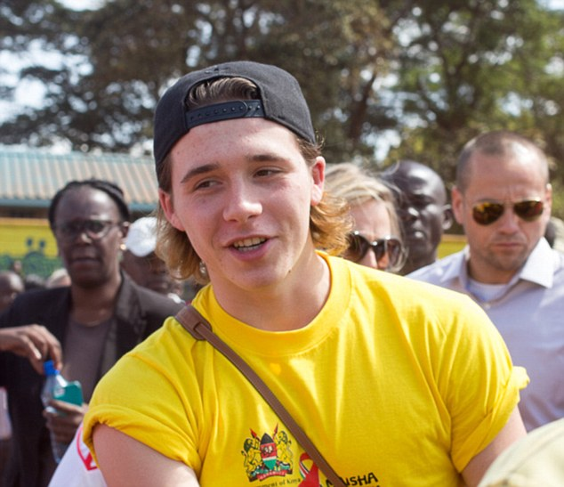 Following in David's footballing footsteps: Brooklyn Beckham showed off his football prowess as he kicked off a tournament in Kenya to involve young people in the fight against HIV and AIDS