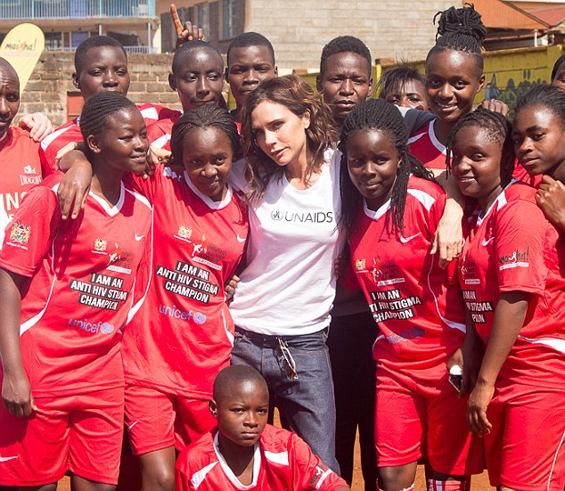 Helping hand: The 17-year-old and fashion designer mum Victoria, 42, have spent three days in the East African country as part of her role as UNAIDS Goodwill Ambassador