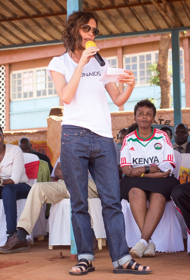 Reaching out: The mother and son team arrived at Kihumbuini football ground in Nairobi's Kangemi slum on Saturday afternoon to launch the Maisha County League