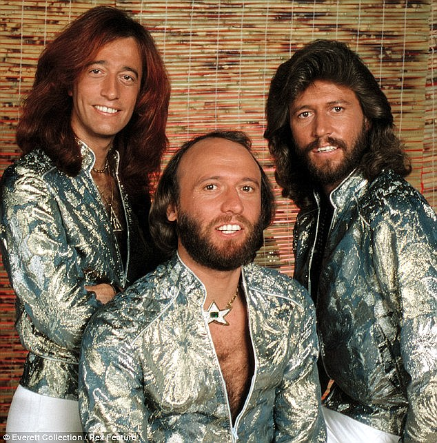 And then there was one: Barry has revealed his late brothers Maurice and Robin'really didn't ever want (him) to make a solo album'
