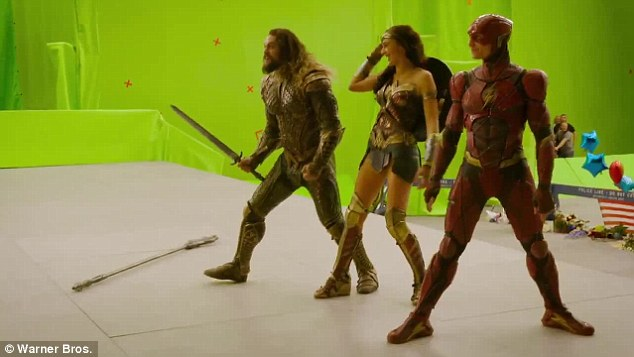 Scene stealer: He then takes Wonder Woman¿s sword so he can charge at an invisible enemy