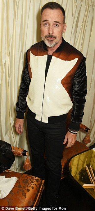 Handsome: Kylie Minogue's exAndres Velencoso was looking sharp for the occasion (L) while David Furnish opted for a striking cream and tan bomber jacket (R)