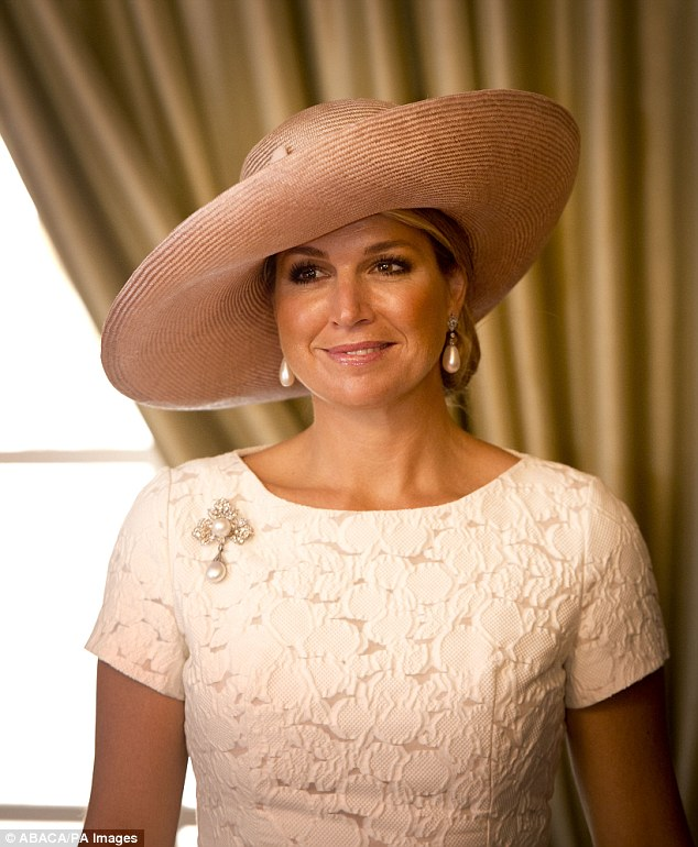 Rarely seen without her beloved hat Queen Maxima displayed her usual wide-brimmed Millinary this afternoon