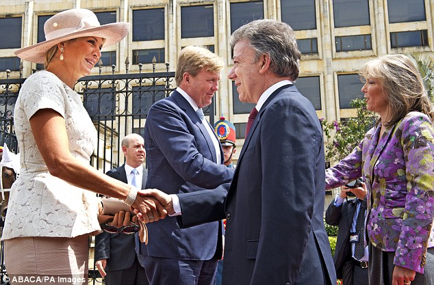 The friendly royal greeted the president with a handshake and a smile upon their arrival