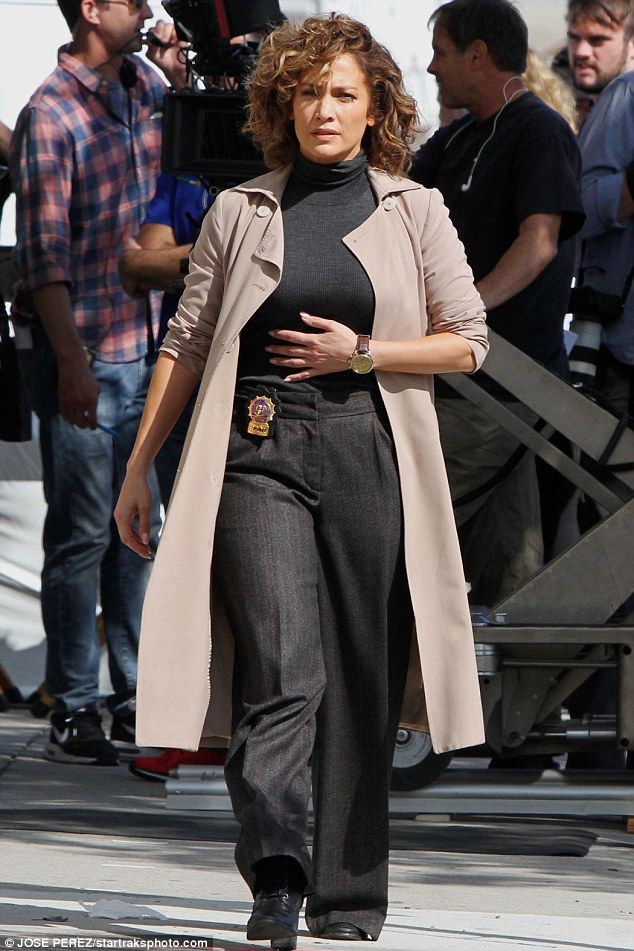 On set: Jennifer Lopez covered her curves in a trench coat while filming Shades of Blue in Brooklyn on Thursday