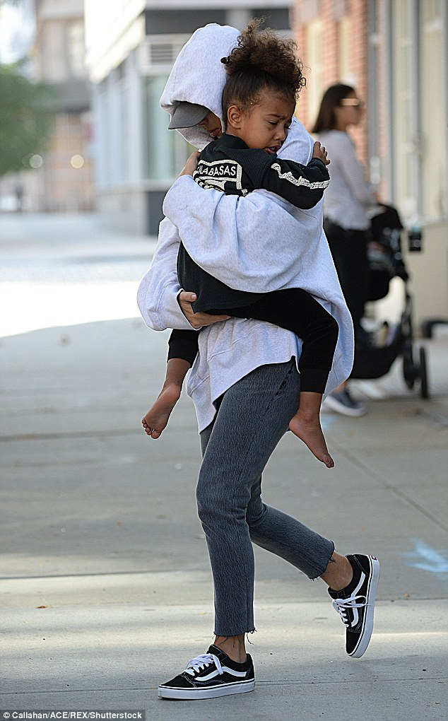 Kardashian appeared to criticise the hotel worker in reports  in the USA in which she described how 'calm' the man remained during the terrifying raid. Pictured: With eldest child North West
