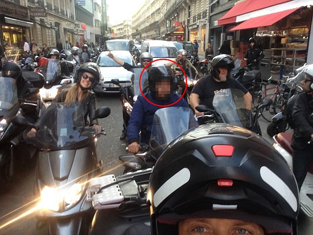 The jewel thieves were 'native French-speakers aged between 40 and 50 and European [white]', according to the descriptions given to police by the hotel concierge. Pictured:A man on a motorcycle following Kim aroused suspicions among photographers
