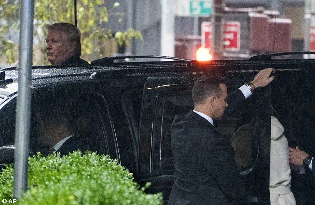 A few hours after the tweets were posted, Trump (left) was spotted leaving Trump Tower in Manhattan