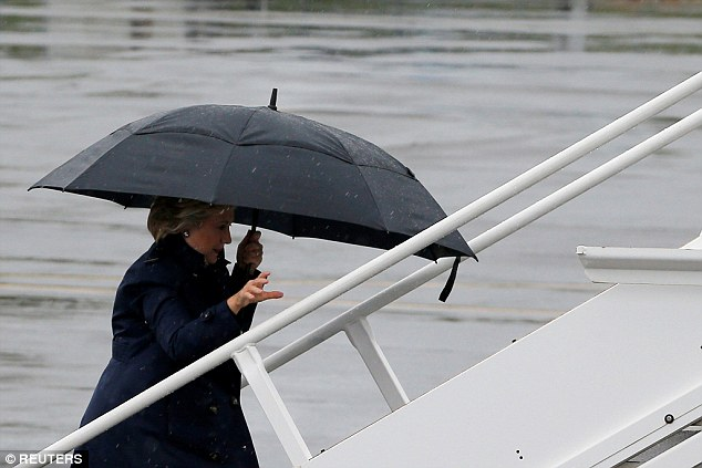 Clinton boarded her campaign plane early on Sunday despite cold and rainy weather in New York