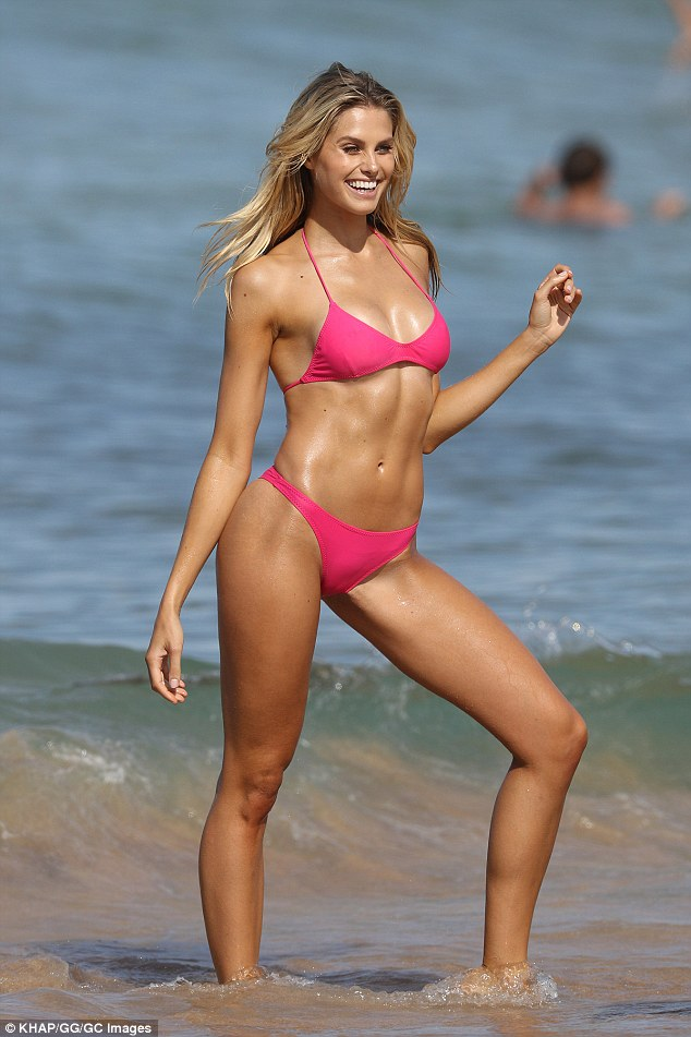 She's flawless! Australian model Natalie Roser looked simply flawless in a skimpy pink bikini during a beach photo shoot in Sydney on Friday