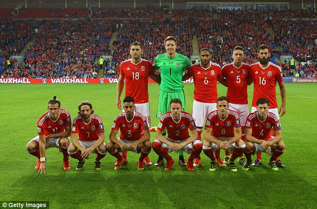 Bale and Joe Allen look somewhat outcast in their team photo before the qualifier vs Moldova