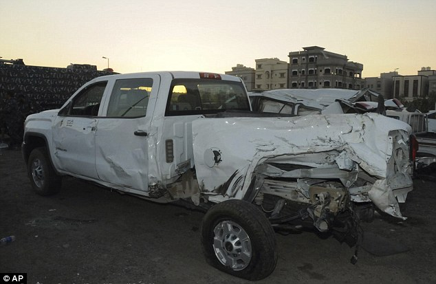 The white pickup truck apparently carrying the soldiers had the left side of its bed smashed in