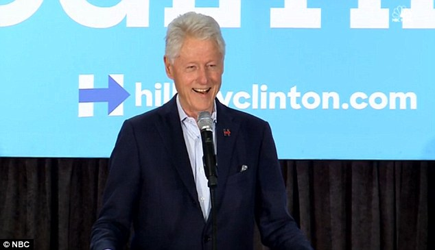 After two men were escorted out of the hall Clinton said: 'They had a bad day yesterday so they¿re trying to make it up'