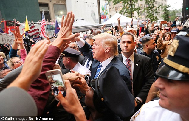 Donald Trump greets supporters outside of Trump Towers in Manhattan October 8, 2016 in New York City