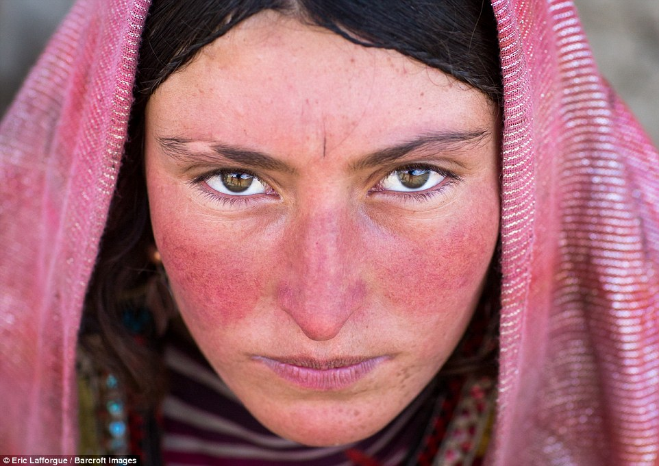 A Wakhi nomad woman in a pink headscarf. The area where she lives has been encouraged to attract tourists from the Western world looking for adventure